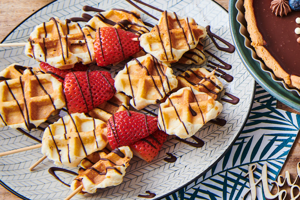 Waffle sticks with strawberries and chocolate