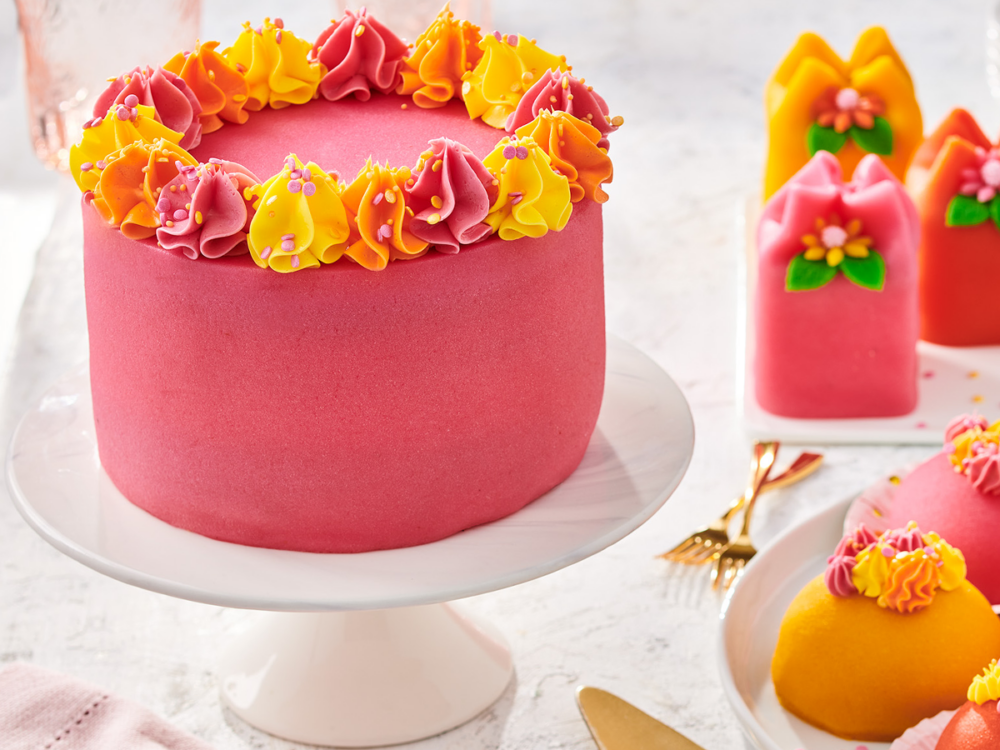 Marzipan cake with fruit and whipped cream filling